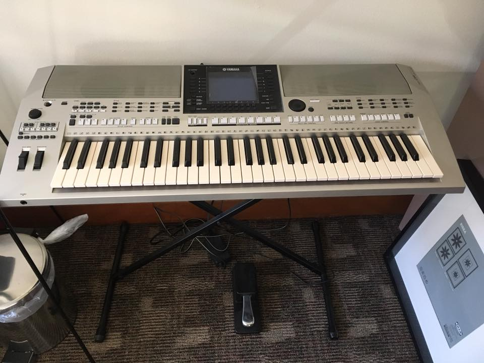Oriental Sounds Yamaha Keyboard with notebender, foot pedal, and power chord, keyboard on a stand.